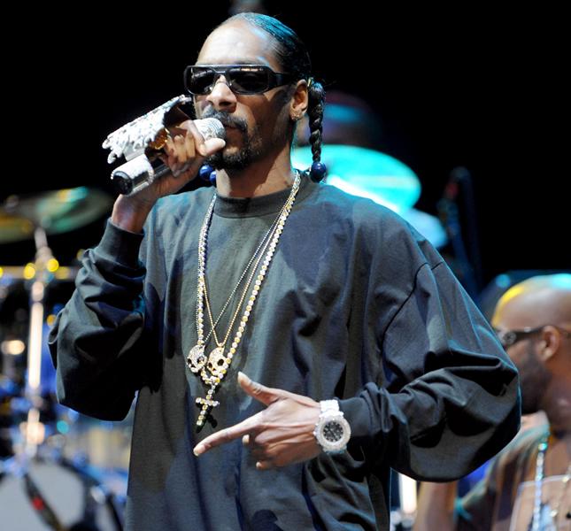 Segundo Snoop Dogg, o mundo do rap é como um 'vestiário cheio de machões' (Foto: Reuters)